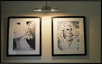 Jax Fashion Illustrations displayed on a wall